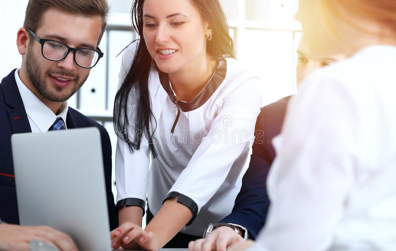 Business people team at meeting in office. Focus at business woman pointing into laptop. Teamwork or coaching concepts stock photos