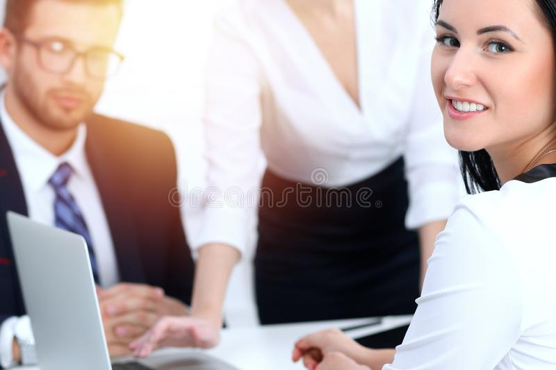 Business people team at meeting in office. Focus at business woman pointing into laptop. Teamwork or coaching concepts stock photo