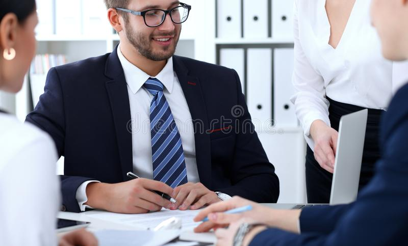 Business people team at meeting in office. Focus at business woman pointing into laptop. Teamwork or coaching concepts royalty free stock photos