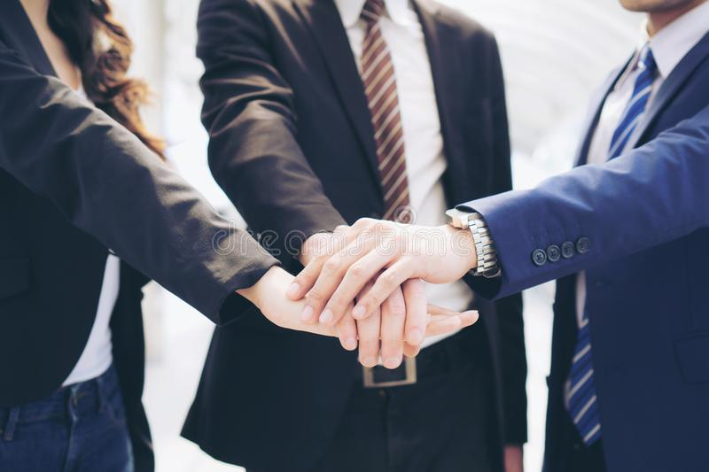 Business People teamwork stacking hands showing unity royalty free stock photos