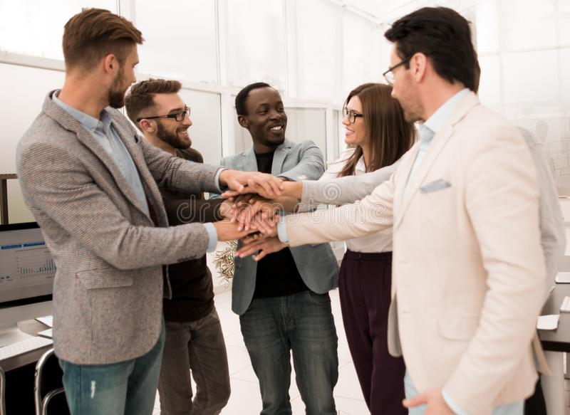 Business People teamwork stacking hands showing unity royalty free stock photography