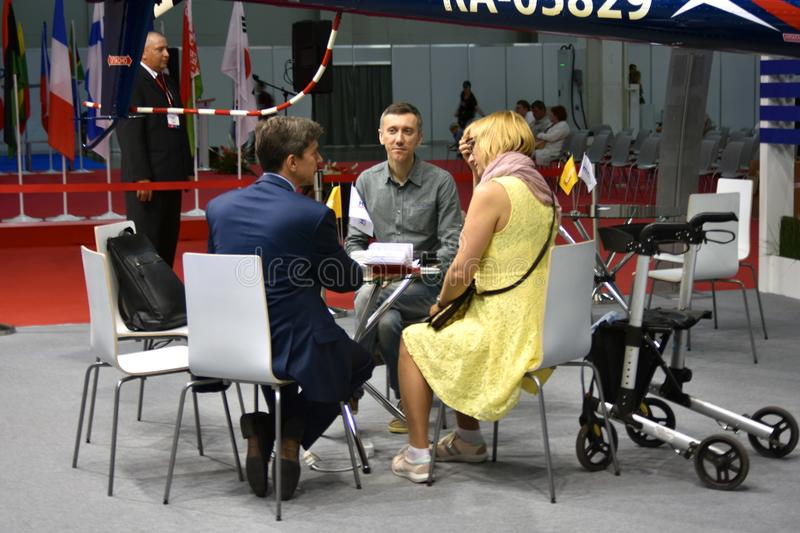 Business people at 11th international exhibition of helicopter industry HeliRussia 2018. royalty free stock photo