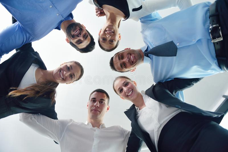 Business people with their heads together stock images