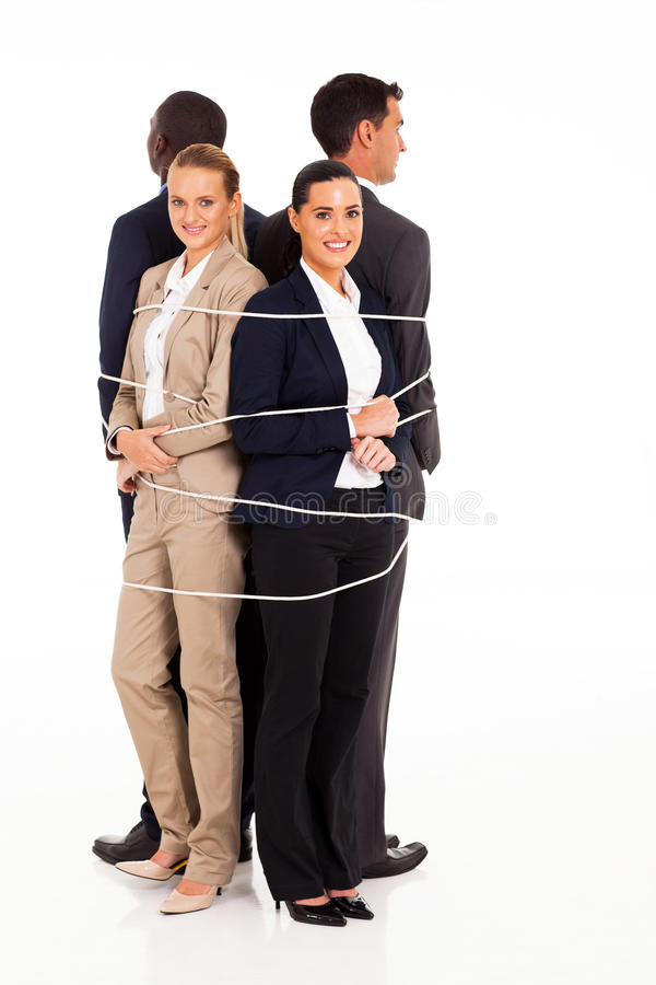 Business people tied. Group of business people tied up together stock photography