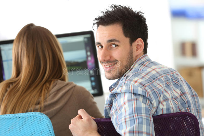 Business people in training class. Business people meeting in front of desktop stock photography