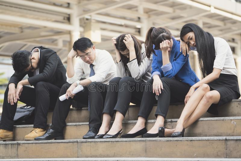Business people unemployed from company sit on street royalty free stock photography