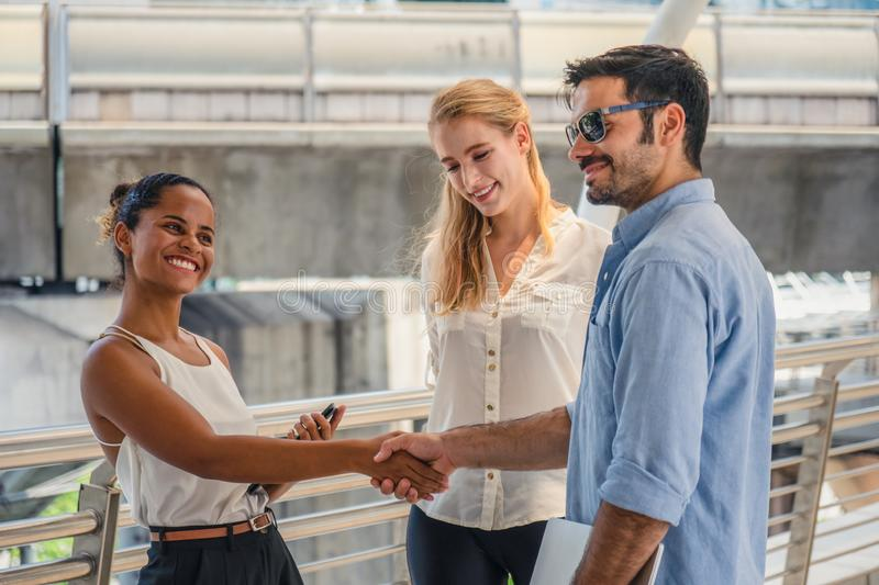 Business people or university students having hands shake outdoor. Diversity of business people or university students having hands shake outdoor stock photo