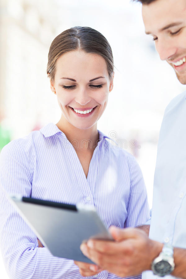 Business People Using Digital Tablet Together Royalty Free Stock Image