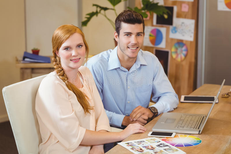 Business people using laptop at desk stock images