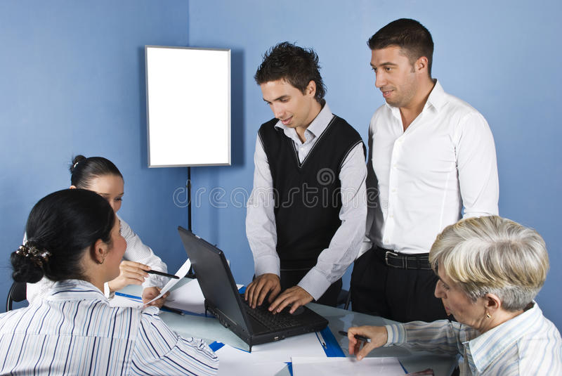 Business people using laptop in office royalty free stock photo