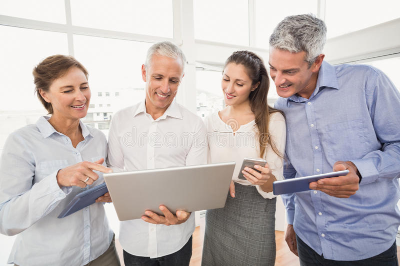 Business people using several electronic devices royalty free stock photos