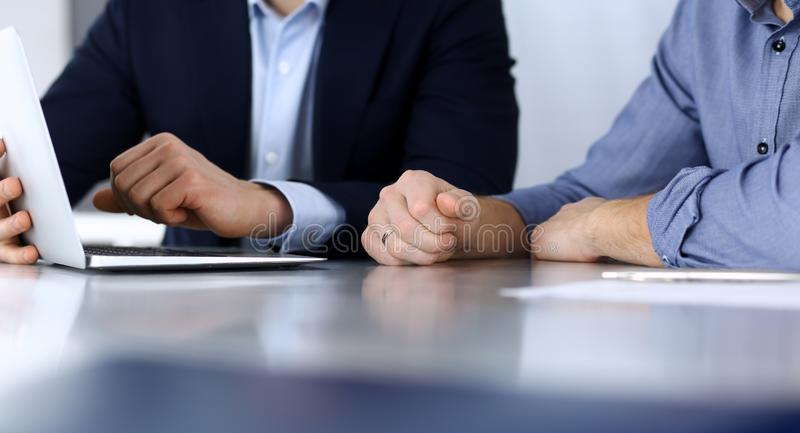 Business people using tablet computer while working together at the desk in modern office. Headshot of businessman or male entrepr royalty free stock images