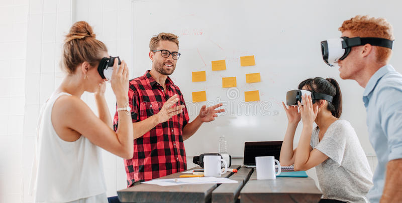 Business people using virtual reality goggles during meeting royalty free stock image
