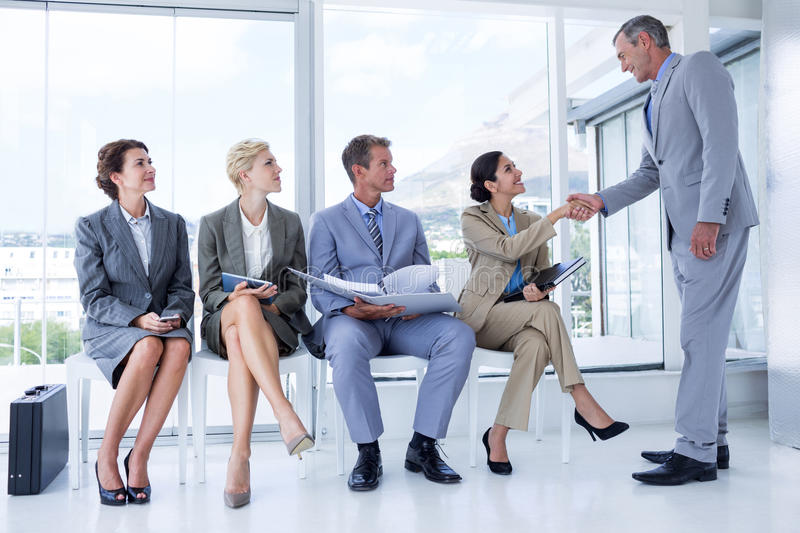 Business people waiting to be called into interview royalty free stock photos