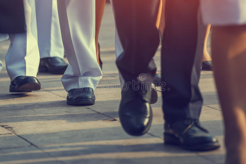 Business people walking on the city street at rush hour royalty free stock photos
