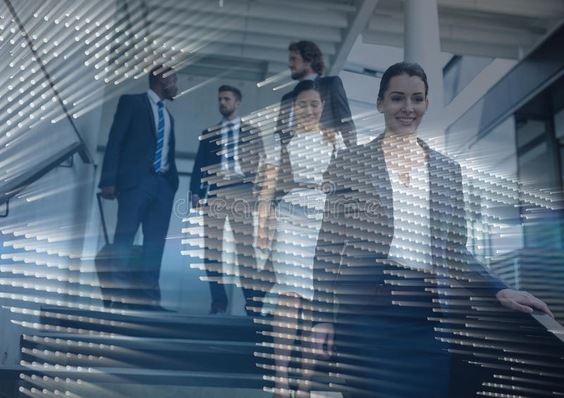 Business people walking down stairs with map graphic overlay stock images