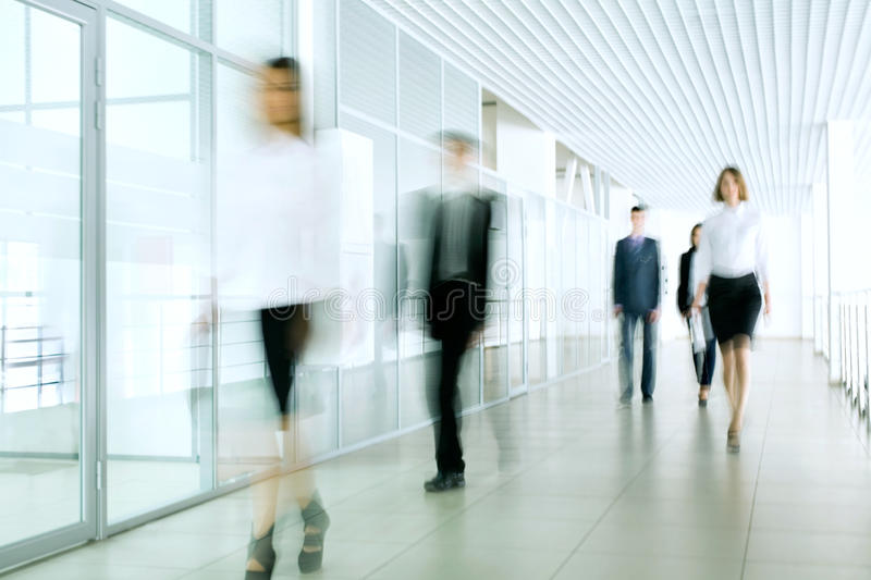 Business people. Walking in the office corridor stock photo