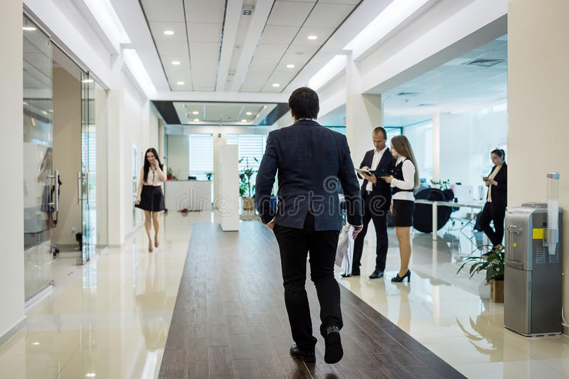 Business people walking in the office corridor,Business People C. Ommuting Concept,Businessman running fast,Employees going against the office.Confident business royalty free stock photos