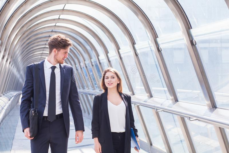 Business people walking in office corridor interior royalty free stock photos