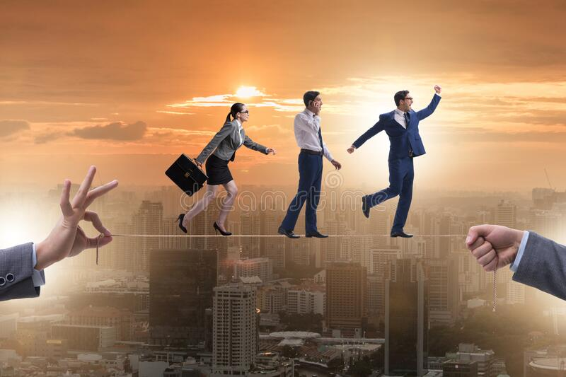 Business people walking on tight rope royalty free stock images