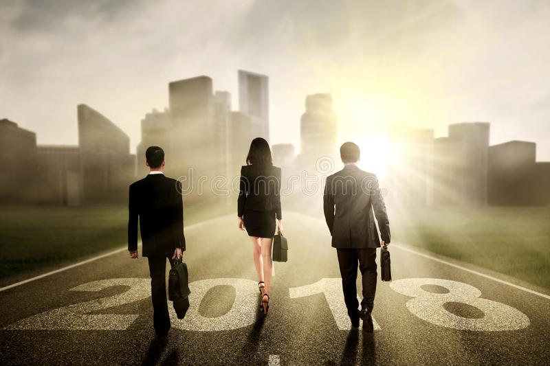 Business people walking toward a city royalty free stock photos