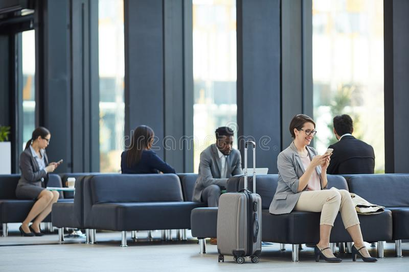 Business people wasting time in airport royalty free stock photo