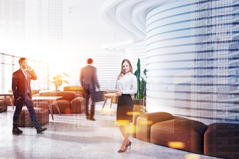 Business people in white office waiting room. Business people walking and standing in modern office waiting room with white walls and comfortable brown sofas royalty free stock images