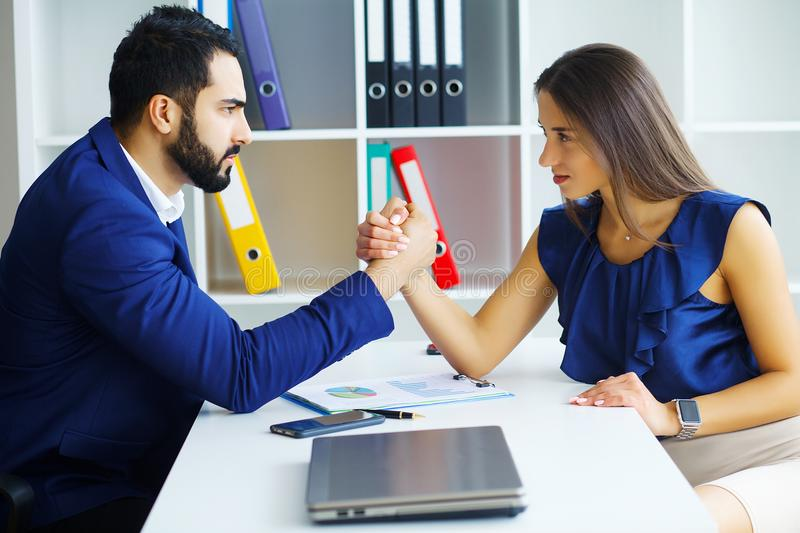 Business people woman and man arm wrestling. Business people women and men arm wrestling stock photos