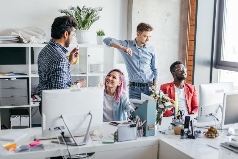 Business people at work in a busy luxury office space stock photo