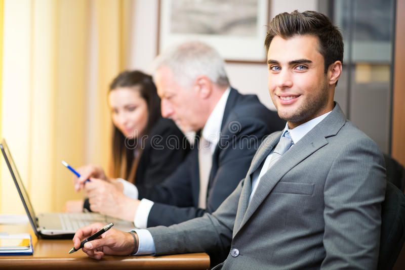 Business people at work in the office stock images