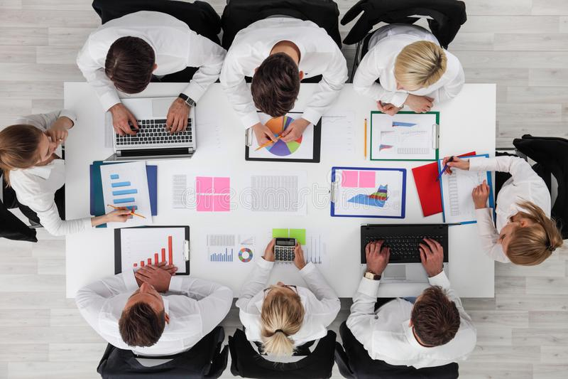 Business people work with statistics royalty free stock photo