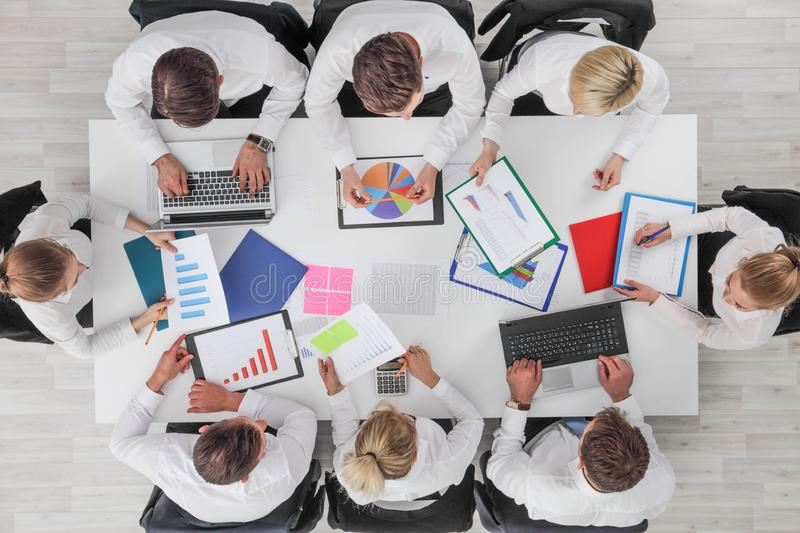 Business people work with statistics royalty free stock image