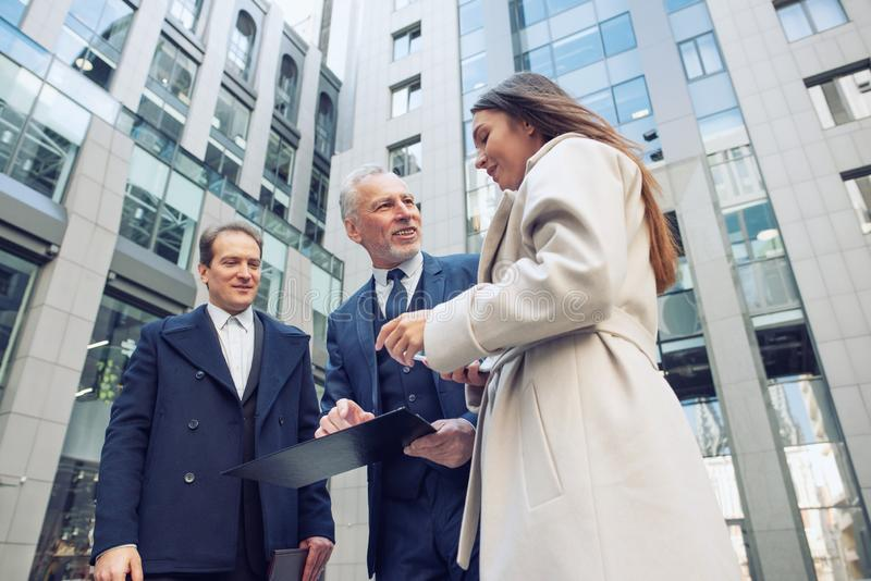 Business people that work together in office. Concept of teamwork and partnership royalty free stock photo