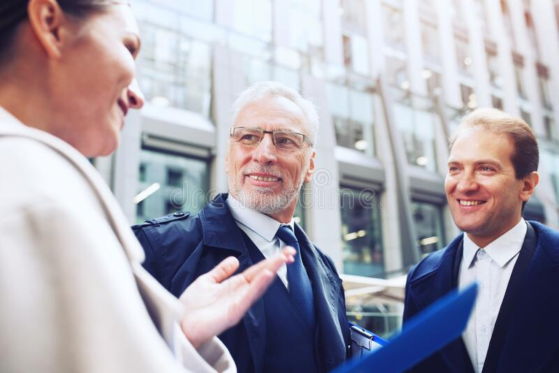 Business people that work together in office. Concept of teamwork and partnership stock photo