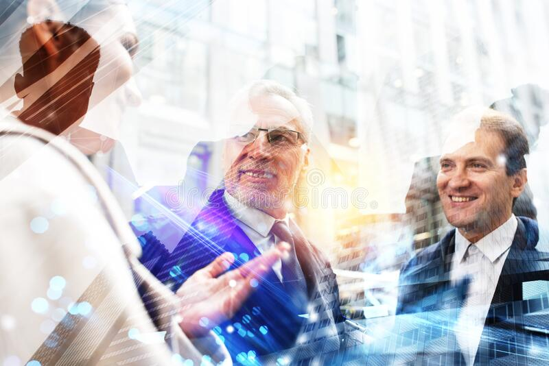 Business people that work together in office. Concept of teamwork and partnership. Double exposure stock photo