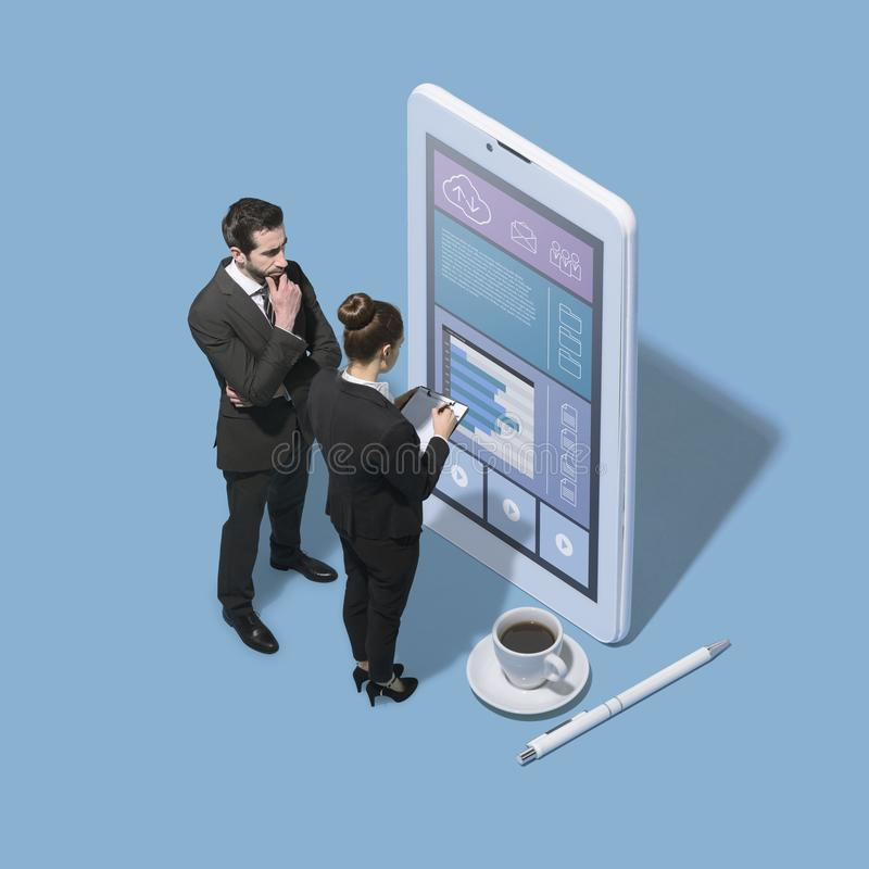 Business people working with a big touch screen smartphone royalty free stock photography