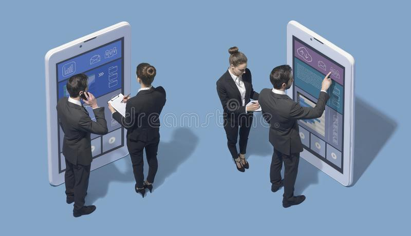 Business people working with big touch screen smartphones stock photography
