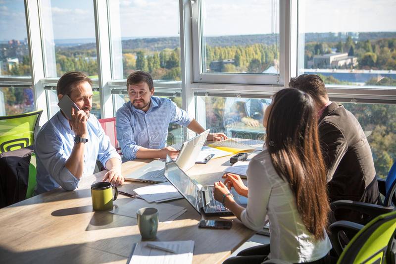 Business people working in board room in office stock photos