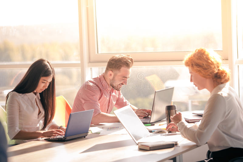 Business people working in board room in office stock photography