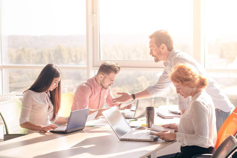 Business people working in board room in office stock image