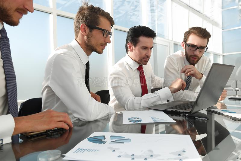 Business people working and communicating while sitting at the office desk stock image