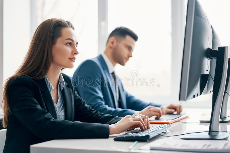 Business people working on computer in his workplace royalty free stock images