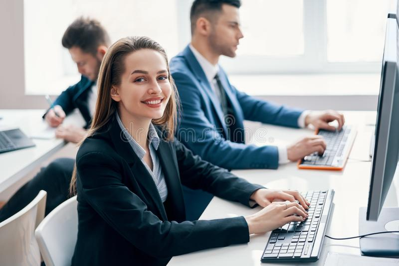 Business people working on computer in his workplace stock photos