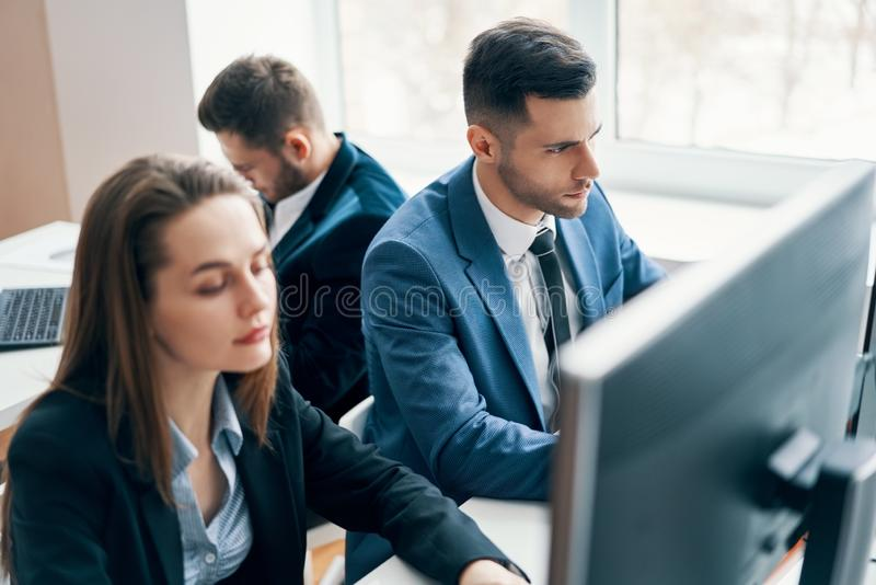 Business people working on computer in his workplace stock image