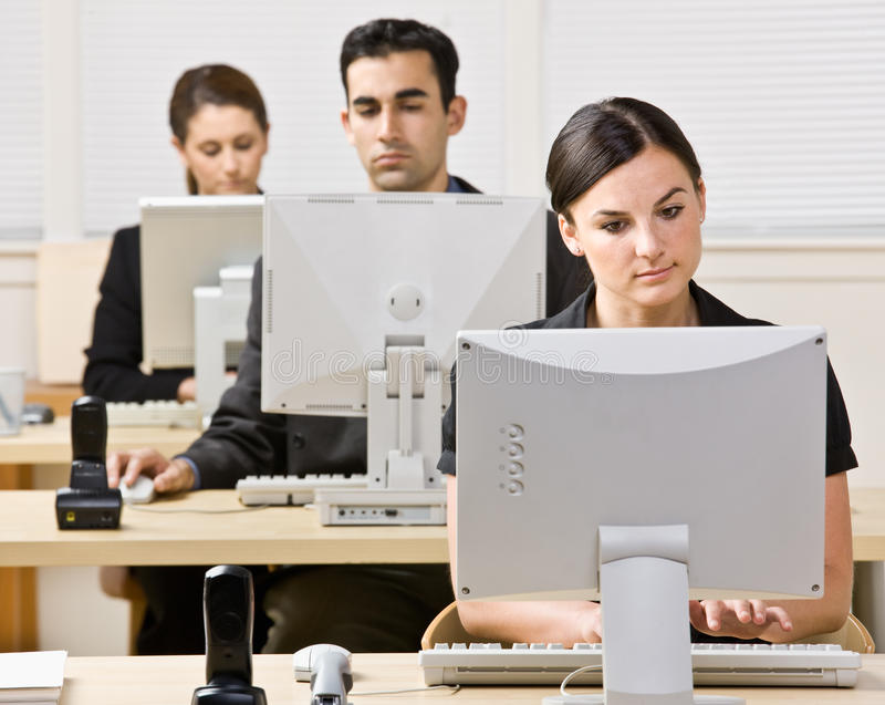 Business people working on computers royalty free stock photo
