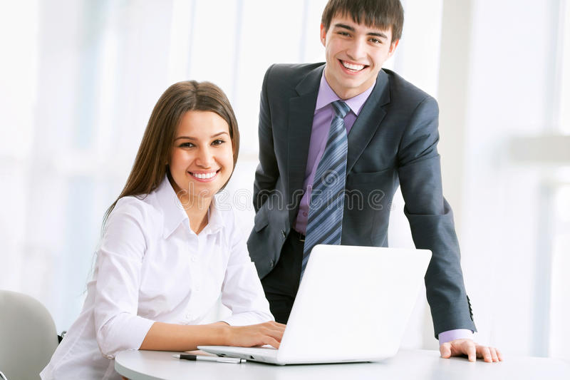 Business people working on laptop stock photos