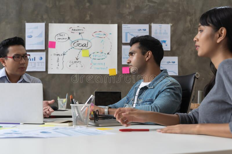 Business people are working on laptop at creative office workplace. Asian creative team meeting and working design planning ideas stock photos