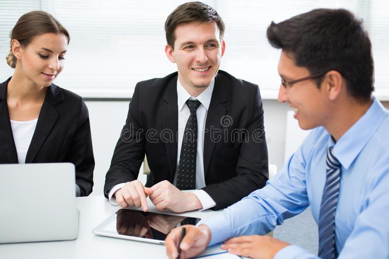 Business people working in an office stock photos