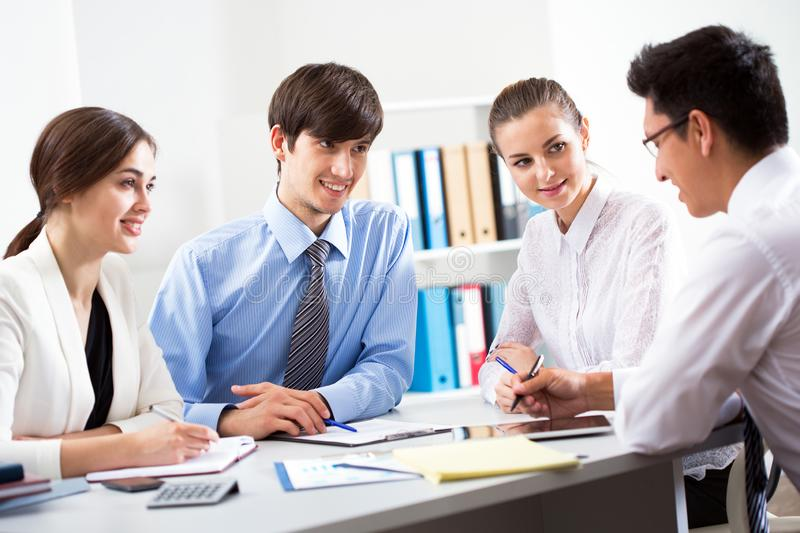 Business people having meeting in an office stock photo