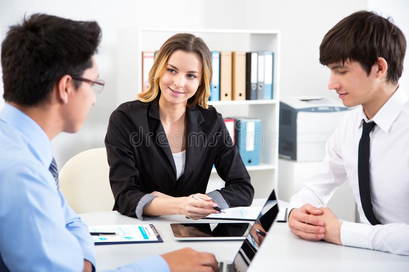 Business people working in an office stock image